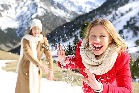 friends throwing snowballs in a snowy