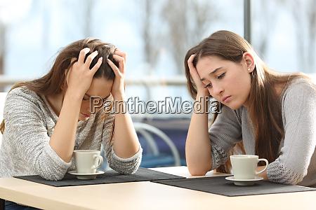 two sad women in a coffee