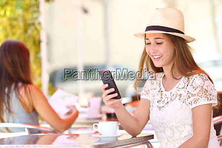 girl checking phone alone in a