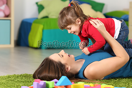happy mother playing with her daughter