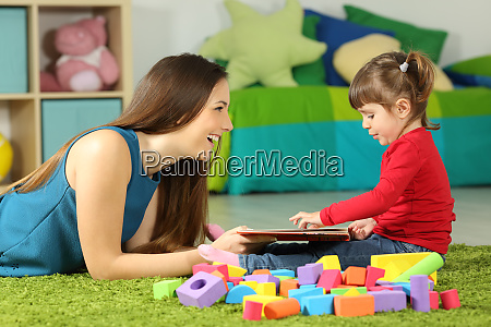 mom and toddler playing with a