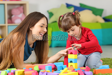 mother and daughter playing with construction