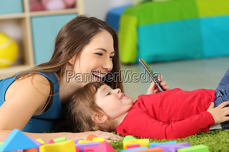 mother and toddler playing with a