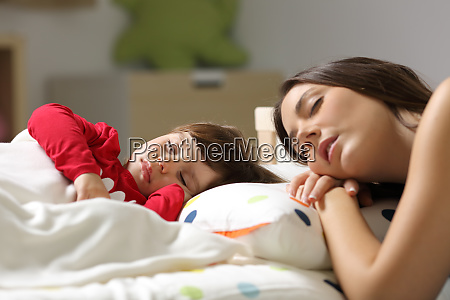 mother and toddler sleeping in a