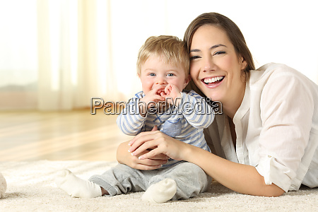smiley mother and baby looking at