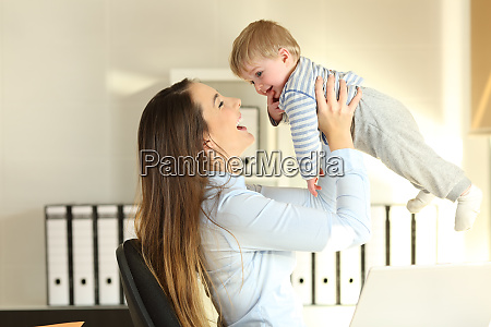 working mother raising her baby son