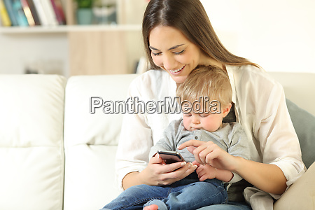 mother showing smart phone content to