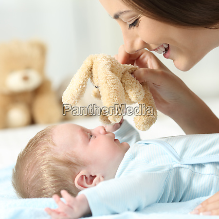 mother playing with her baby with
