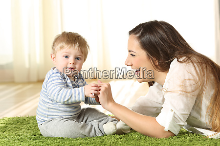 mother playing with her kid that