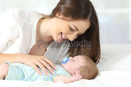 mother enjoying with her baby sleeping