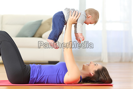 mother exercising with her baby at