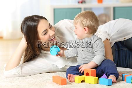 joyful mother and baby playing on