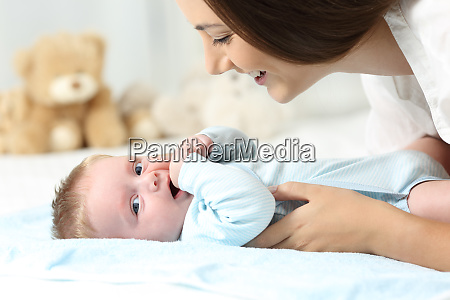 mother and baby on a bed