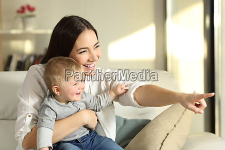 mother and son looking through a