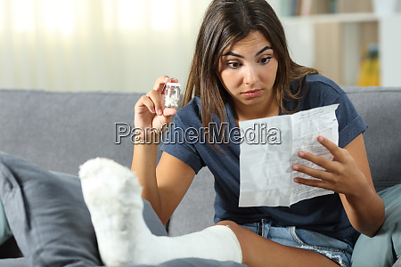 confused disabled woman reading pill leaflet