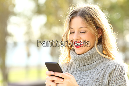 happy woman reading text on phone