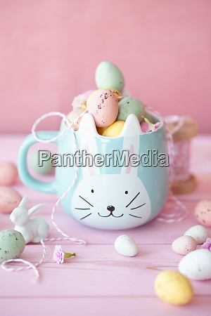 cheerful mug with easter eggs