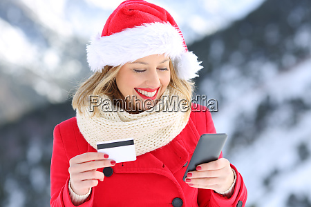 woman paying on line with credit