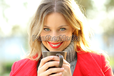 woman looking at you holding a