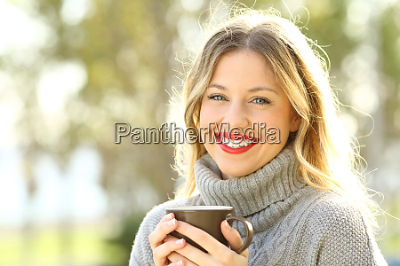happy woman looking at camera with