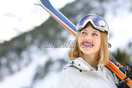 happy skier looking above in the