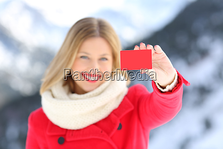 woman showing a credit card in