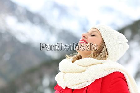woman breathing fresh air in winter