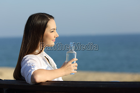 smiley woman holding a water bottle