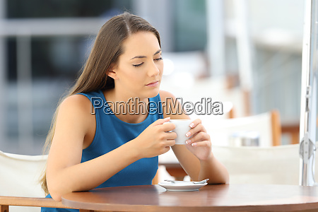 pensive sad lady in a coffee