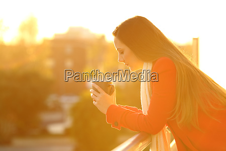 pensive worried woman at sunset