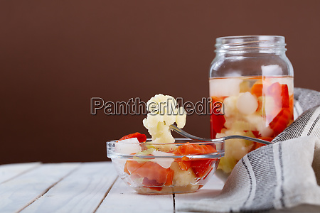 marinated various vegetables in a glass