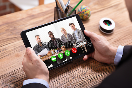 businessman videoconferencing with her colleagues on