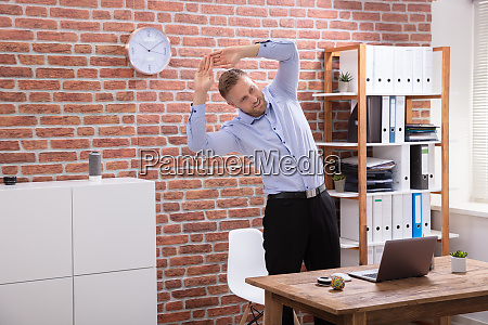 businessman exercising at workplace