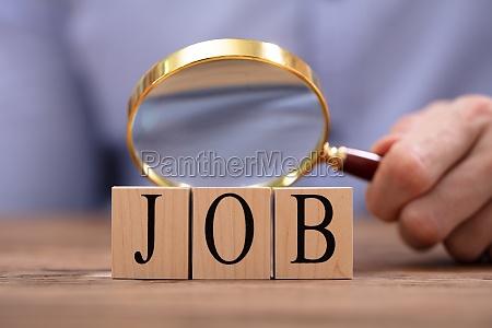 person looking at job blocks through