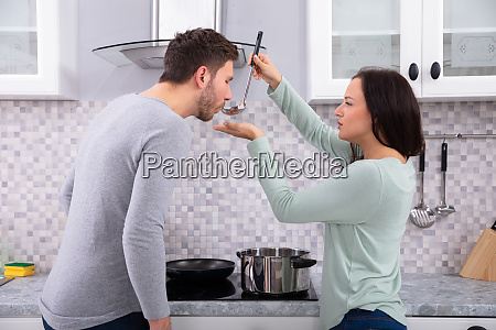 husband and wife tasting food in
