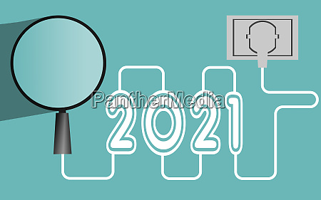 magnifying glass and year 2021 with