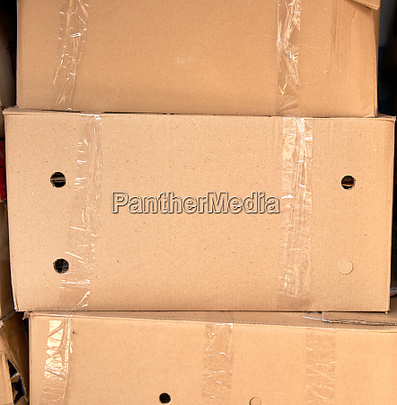 stack of brown cardboard boxes