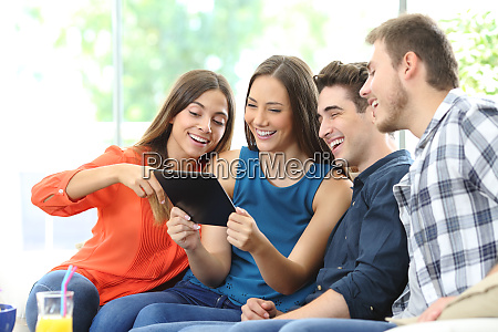 group of friends checking tablet content