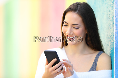 happy woman is browsing smart phone