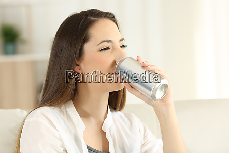 woman drinking a soda refreshment from