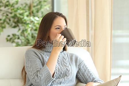 woman drinking coffee in winter