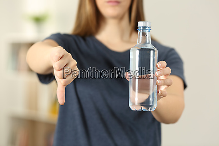 woman hands holding a bottle of