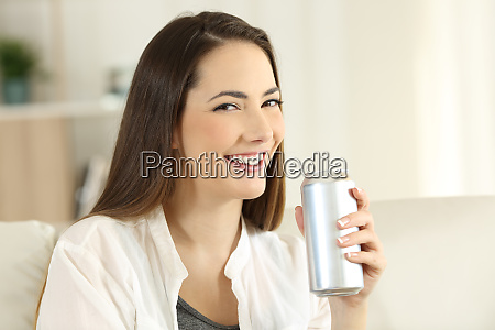 woman holding a refreshment can looking