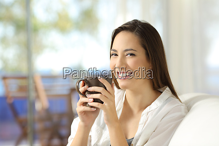 woman looking at camera holding a