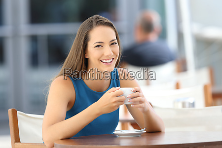 woman posing looking at you in