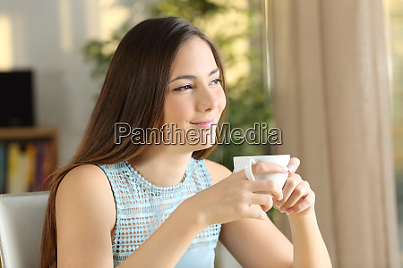 woman relaxing looking at side holding