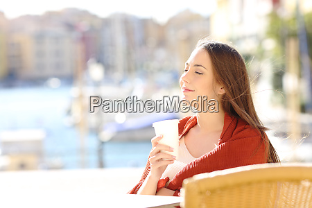 woman relaxing holding a drink in