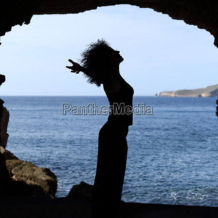 happy woman silhouette breathing on the