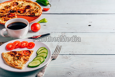 frittata on plate and cup of