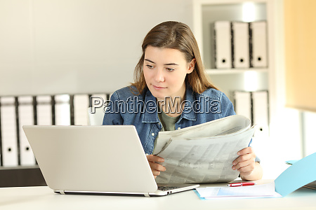 intern comparing news in a laptop